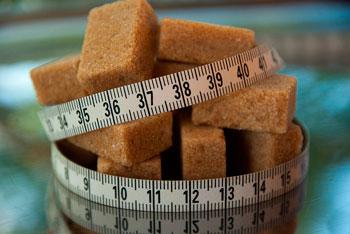Zuckerwürfel und Maßband